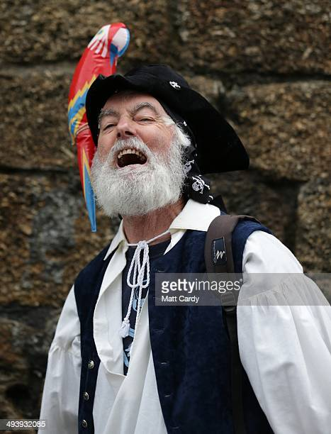 Pat Sargent dressed as a pirate poses for a photograph as people gather to attempt to reclaim the Guiness World Record for the most pirates in one...