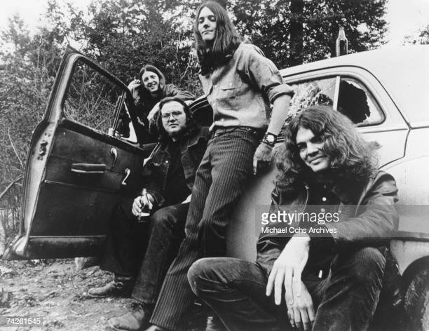 Pat Simmons John Hartman Dave Shogren and Tom Johnston of the rock and roll band 'The Doobie Brothers' pose for a portrait with a car in circa 1970