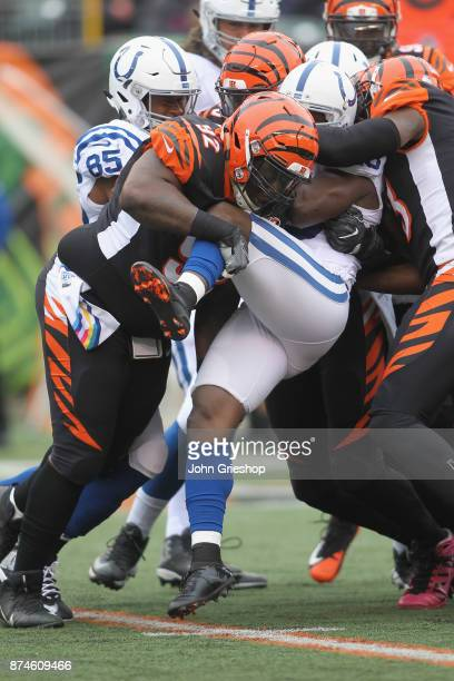 Pat Sims Carlos Dunlap and George Iloka of the Cincinnati Bengals make the tackle on Frank Gore of the Indianapolis Colts during their game at Paul...