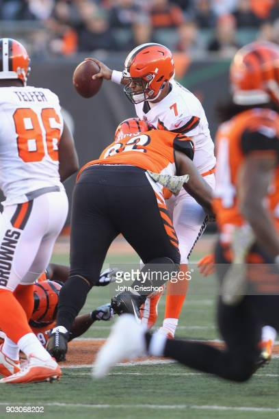 Pat Sims of the Cincinnati Bengals makes the hit on DeShone Kizer of the Cleveland Browns during their game at Paul Brown Stadium on November 26 2017...