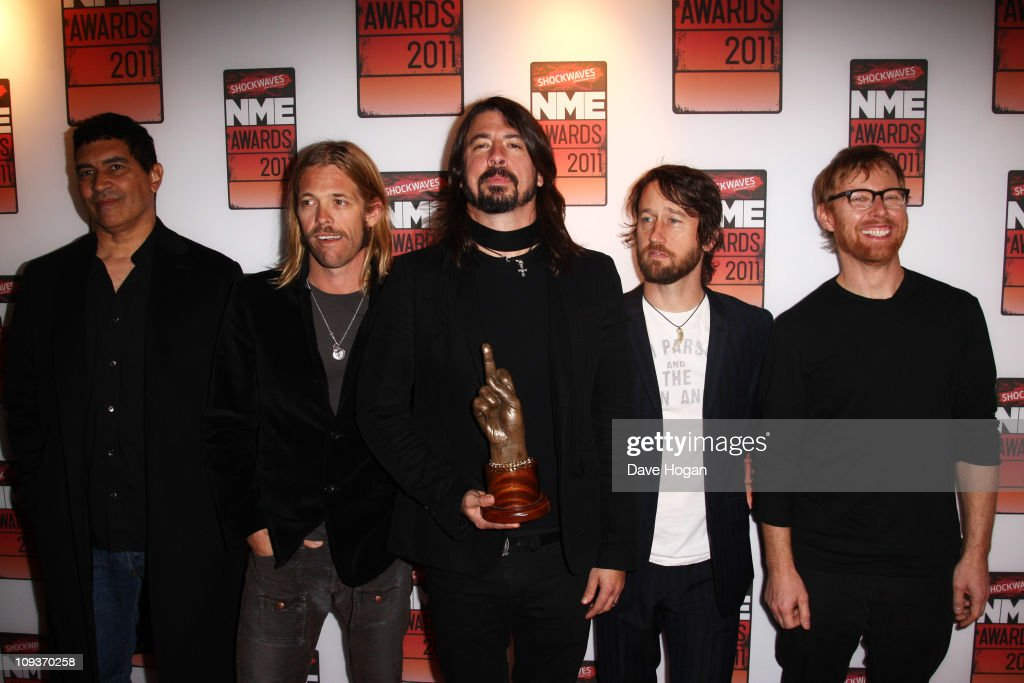 L-R Pat Smear, Taylor Hawkins, Dave Grohl, Chris Shiflett and Nate Mendel of The Foo Fighters attend the Shockwaves NME Awards 2011 held at Brixton Academy on February 23, 2011 in London, England.