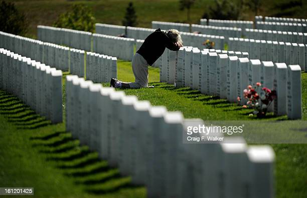 Pat Smith of Denver visits the grave of her husband, Herb, at Fort Logan National Cemetery in Denver, CO, September 11, 2011. This would have been...