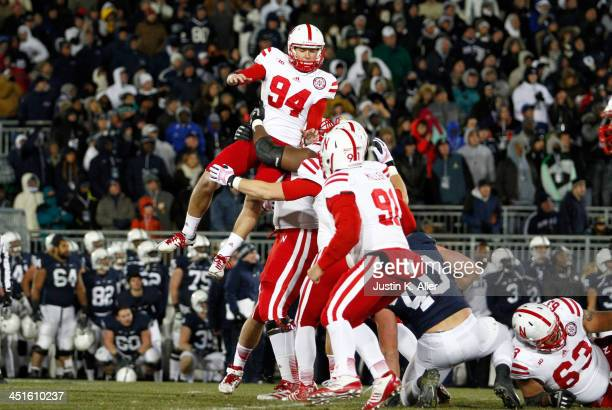 Pat Smith of the Nebraska Cornhuskers celebrates after kicking the game winning overtime field goal against the Penn State Nittany Lions during the...