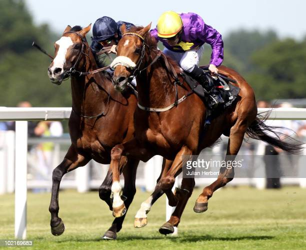 Pat Smullen and Rite Of Passage get the better of the Johnny Murtagh ridden Age Of Aquarius to land The Ascot Gold Cup run on the 3rd Day of Royal...