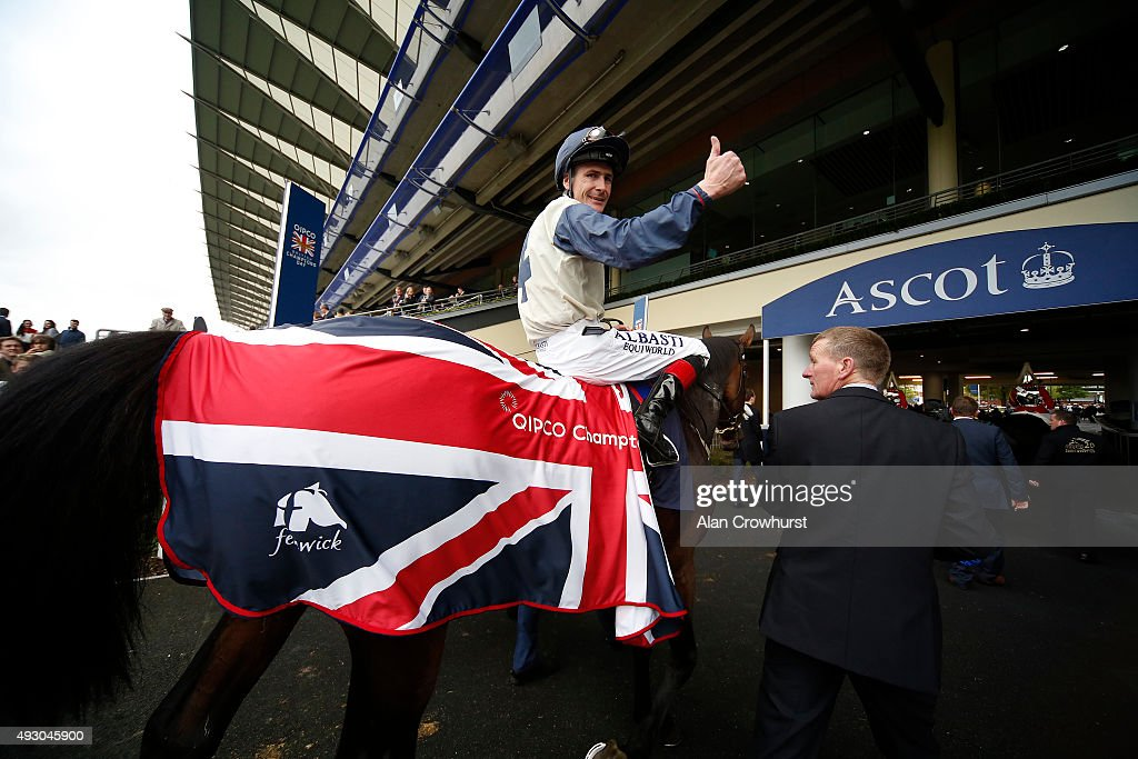 Pat Smullen riding Fascinating Rock win The Qipco Champion Stakes at Ascot racecourse on October 17, 2015 in Ascot, England.