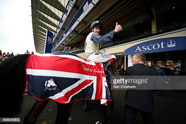 Pat Smullen riding Fascinating Rock win The Qipco Champion Stakes at Ascot racecourse on October 17 2015 in Ascot England