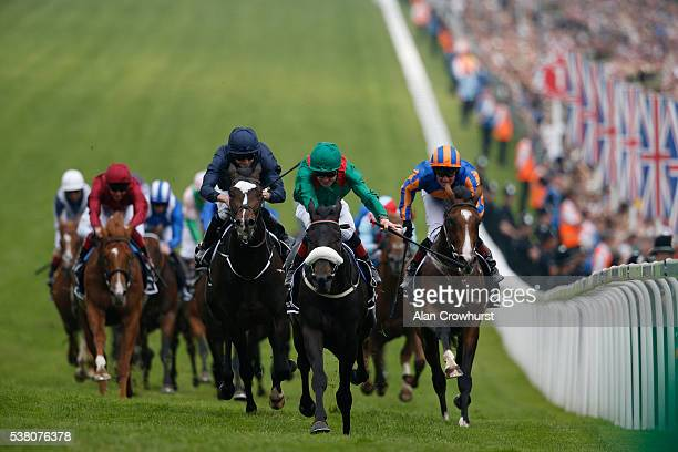 Pat Smullen riding Harzand win The Investec Derby from US Army Ranger and Idaho at Epsom Racecourse on June 4 2016 in Epsom England