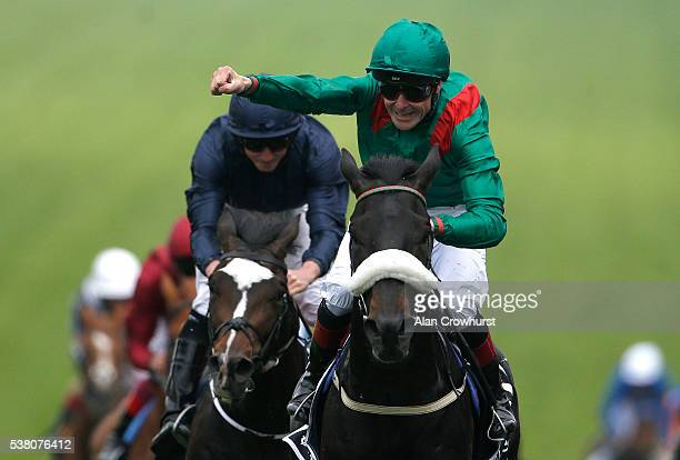 Pat Smullen riding Harzand win The Investec Derby from US Army Ranger and at Epsom Racecourse on June 4, 2016 in Epsom, England.