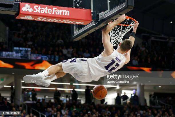 Pat Spencer of the Northwestern Wildcats dunks the ball in the game against the Michigan State Spartans during the second half at WelshRyan Arena on...