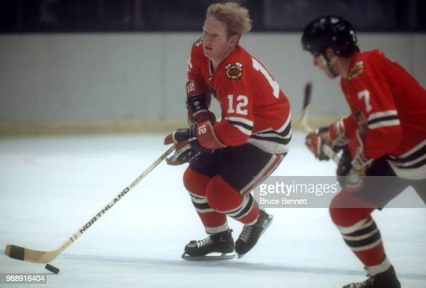 Pat Stapleton of the Chicago Blackhawks skates with the puck during an NHL game circa 1972