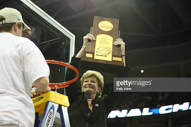 Pat Summit holds up the trophy and cuts the net during the NCAA Women's Basketball National Championship at Quicken Loans Arena in Cleveland, Ohio on...