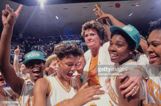Pat Summitt, Head Coach for the Tennessee Lady Volunteers celebrates with the team after winning the NCAA Division I Women's Basketball Tournament...