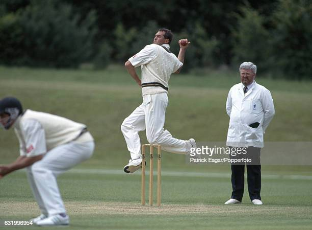 Pat Symcox bowling for South Africa during the tour match between Sir JP Getty's XI and the South Africans at Wormsley Buckinghamshire 20th June 1994