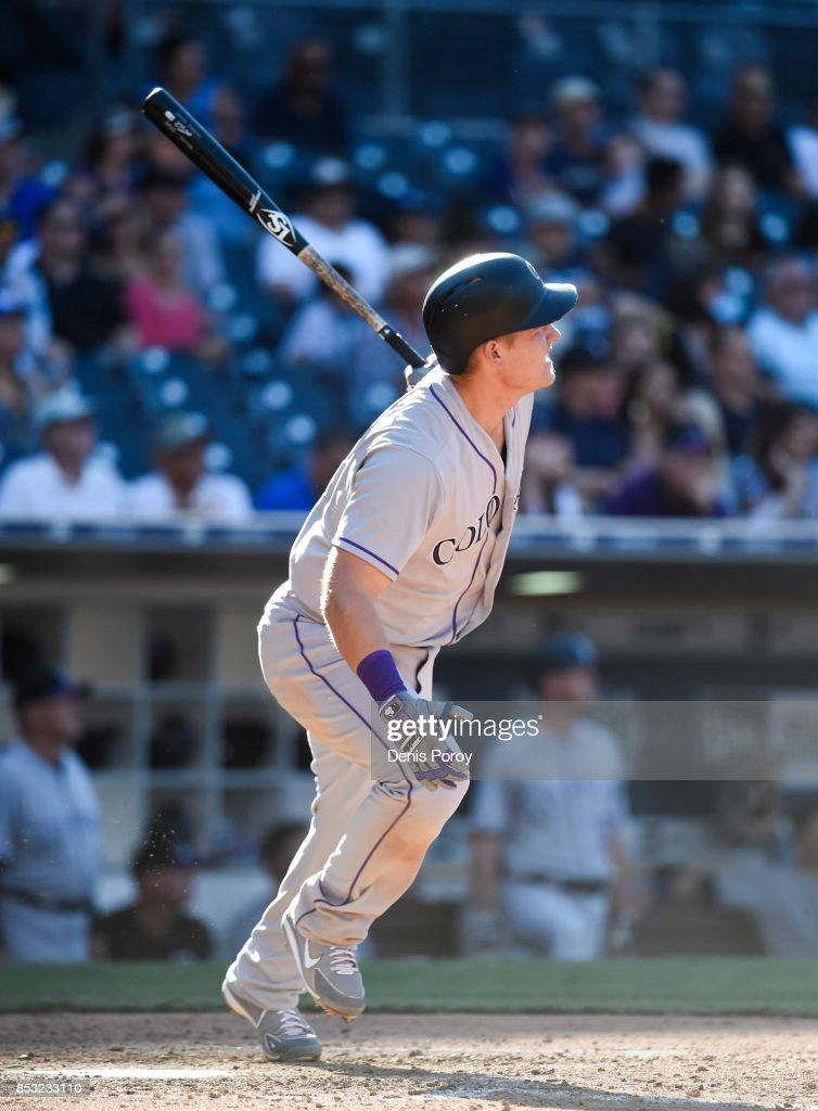 Pat Valaika #4 of the Colorado Rockies hits a solo home run during the ninth inning of a baseball game against the San Diego Padres at PETCO Park on September 24, 2017 in San Diego, California.