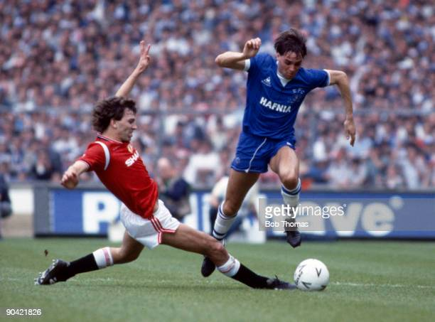 Pat Van Den Hauwe of Everton is tackled by Bryan Robson of Manchester United during the Everton v Manchester United FA Cup Final played at Wembley...