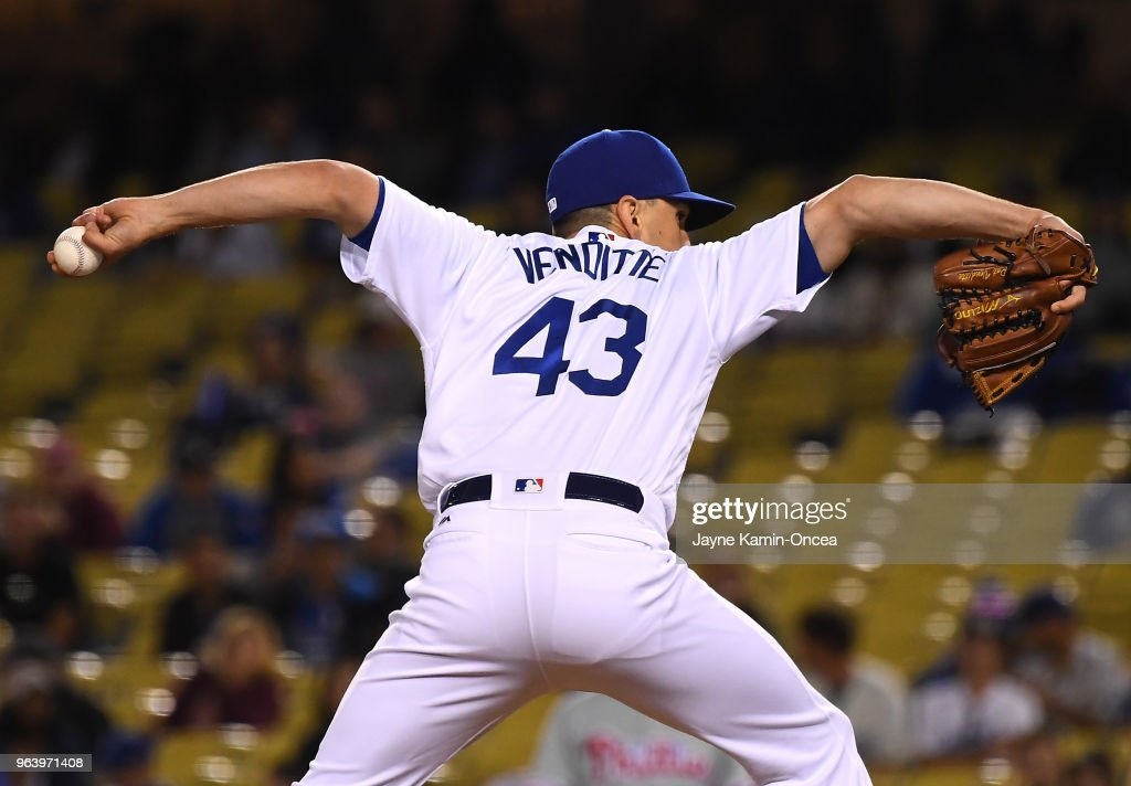 Pat Venditte #43 of the Los Angeles Dodgers pitches from both the left and right side to earn a save in the ninth inning of the game against the Philadelphia Phillies at Dodger Stadium on May 30, 2018 in Los Angeles, California.