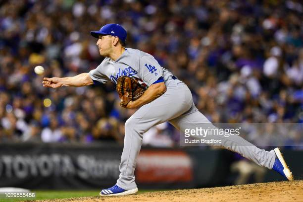 Pat Venditte of the Los Angeles Dodgers throws a pitch right handed against the Colorado Rockies in an inning where he would retire two batters from...