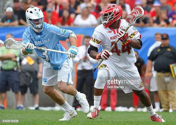 Pat Young of the Maryland Terrapins dodges to the goal against the defense of Brett Bedard of the North Carolina Tar Heels during the second quarter...