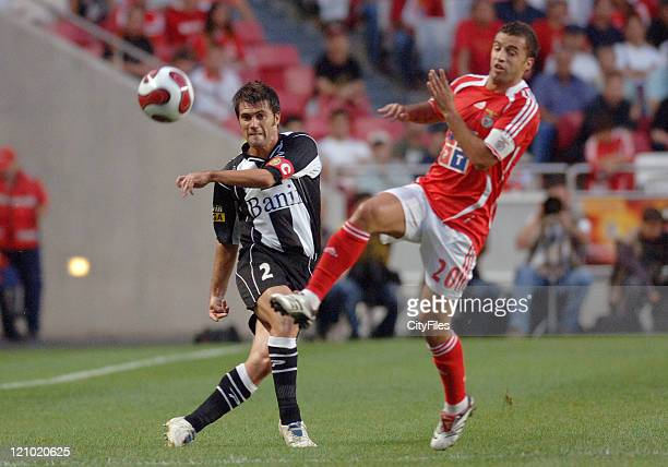 Patacas of Nacional da Madeira and Simao Sabrosa of Benfica in action during the third round of a Portuguese League game between Nacional da Madeira...