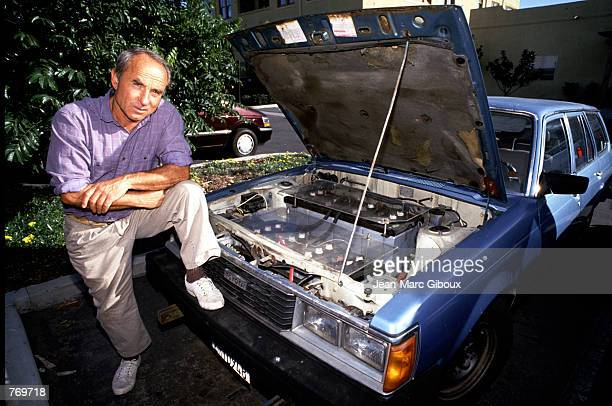 Patagonia store owner Yvon Chouinard poses with his automobile November 21 1993 in California