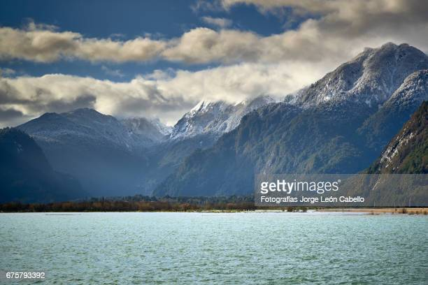 patagonian andes range view in peulla from the catamaran during winter the andean lake crossing - azul turquesa stock pictures, royalty-free photos & images