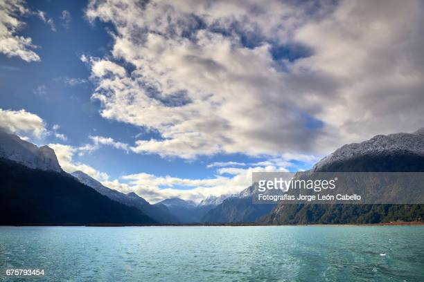 patagonian andes range view in peulla from the catamaran during the winter andean lake crossing - azul turquesa stock pictures, royalty-free photos & images