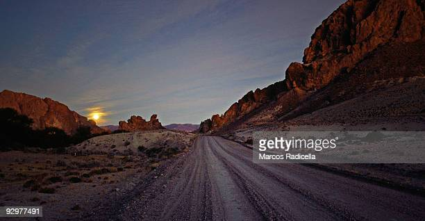 patagonian road at sunset - radicella stock pictures, royalty-free photos & images