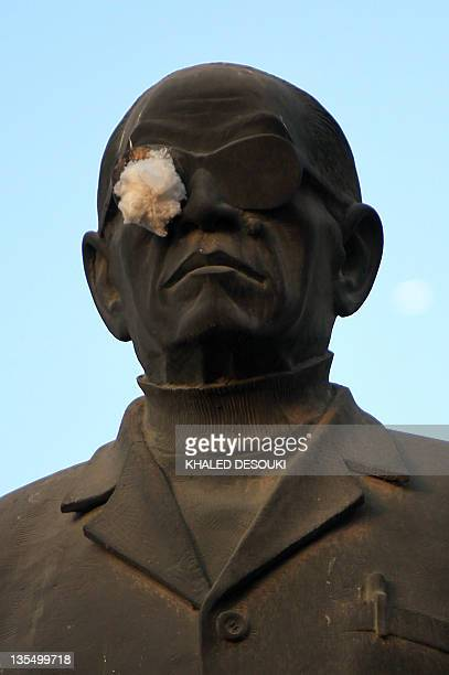 A patch covers the eye of the statue of Egyptian novelist Naguib Mahfouz in Cairo on December 11 2011 in a symbolic tribute to Egyptian protesters...