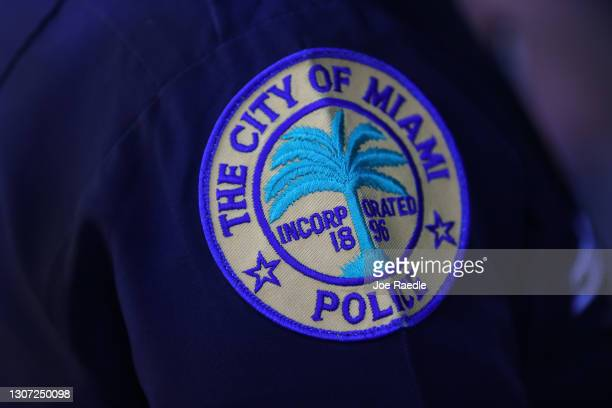 Patch is seen on the shoulder of a police officer as the City of Miami's new Police Chief Art Acevedo speaks to the media during his introduction at...