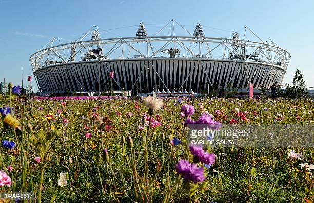 A patch of flowers is pictured in front of the Olympic stadium at the Olympic Park in London on July 22 2012 The London 2012 Olympic Games begins on...