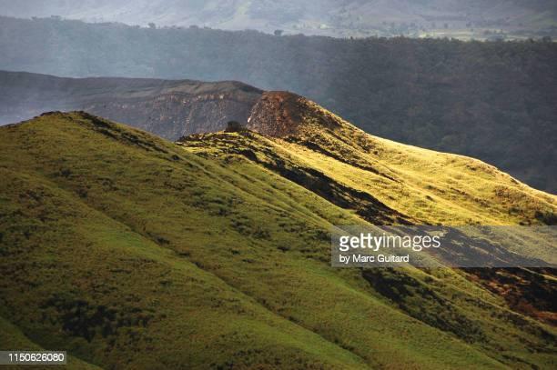 a patch of sunlight on volcan masaya, masaya, nicaragua - masaya volcano stock pictures, royalty-free photos & images