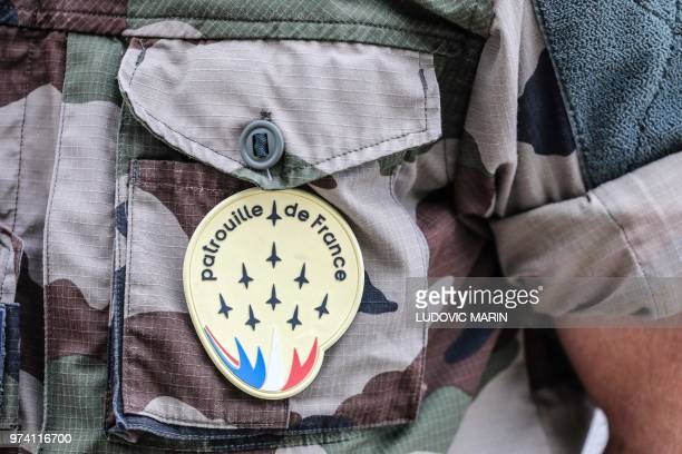 A patch of the French Air Force acrobatic team Patrouille de France is pictured on an officer's uniform during a ceremony commemorating the 40th...