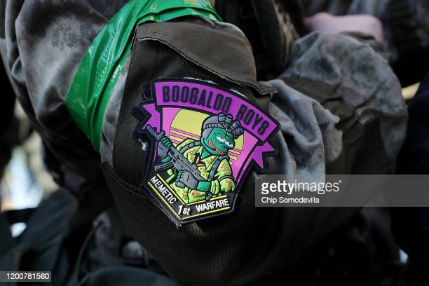 A patch with the image of an armed Pepe the Frog is worn by an attendee during a rally organized by The Virginia Citizens Defense League on Capitol...