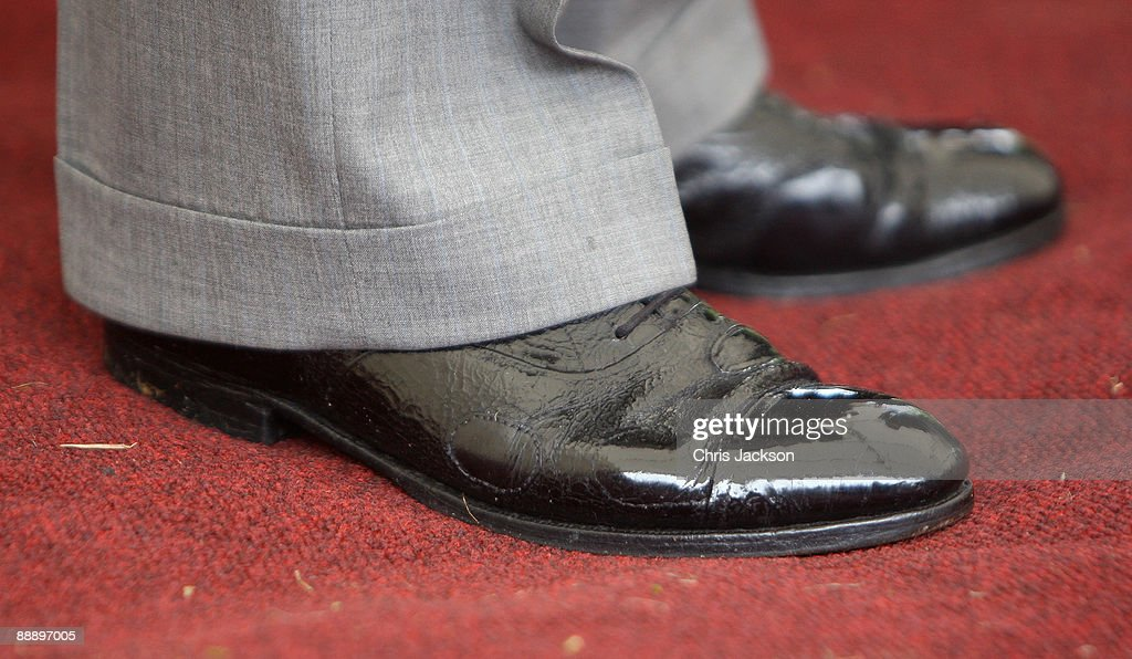 Patches are visible on HRH Prince Charles, Prince of Wales's shoes as he is taken on a tour of St Pancras Almshouses on July 8, 2009 in London, England. The Prince of Wales, patron of The Almshouse Association, presented the Patron's Awards and met residents and community leaders to celebrate the 150th anniversary of the Almshouses.