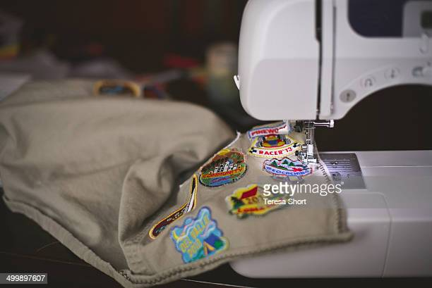 ymca patches being sewn onto vest - patchwork stock pictures, royalty-free photos & images