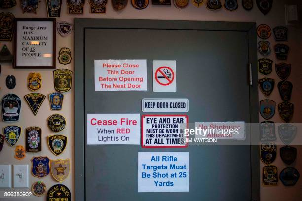 Patches from law enforcement around the US adorn the wall next to the door leading to the shooting range at the Lynchburg Arms Indoor Shooting Range...