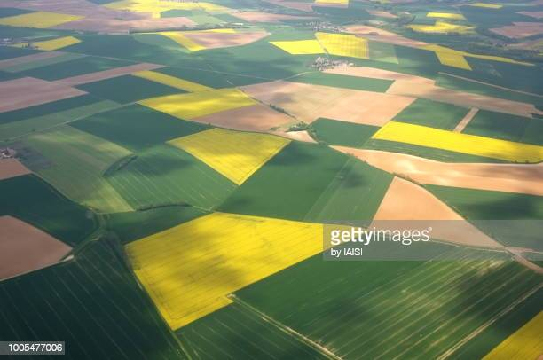 a patchwork landscape of france, full frame - cultivated land stock pictures, royalty-free photos & images