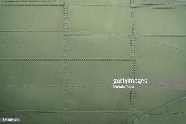 patchwork of riveted metal pieces - fuselage stock photos and pictures