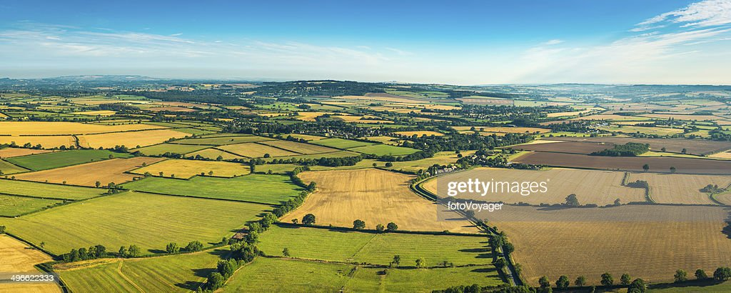 Patchwork quilt landscape of farm fields crops pasture aerial panorama : Stock Photo