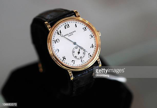 A Patek Philippe Travel Time watch is displayed during a media preview of the auction of personal property that once belonged to Bernard and Ruth...