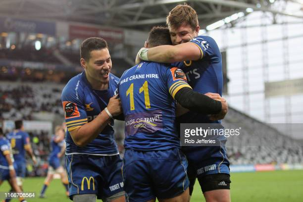 Patelesio Tomkinson and Michael Collins of Otago celebrate a try by Jona Nareki during the round 5 Mitre 10 Cup match between Otago and Taranaki at...