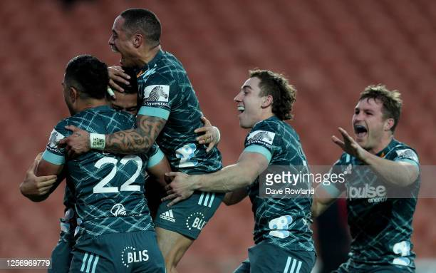 Patelesio Tomkinson of the Highlanders is congratulated by Aaron Smith on scoring a last minute winning try during the round 6 Super Rugby Aotearoa...