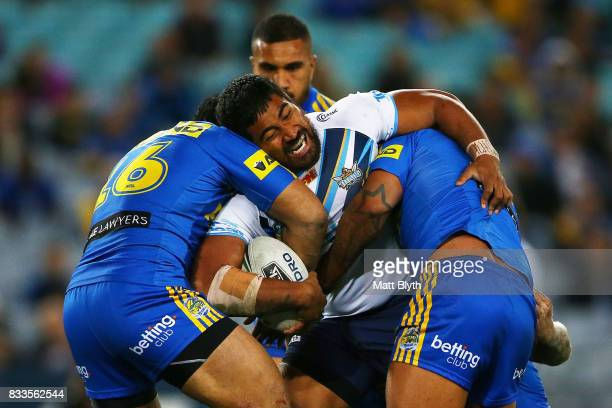 Paterika Vaivai of the Titans is tackled during the round 24 NRL match between the Parramatta Eels and the Gold Coast Titans at ANZ Stadium on August...