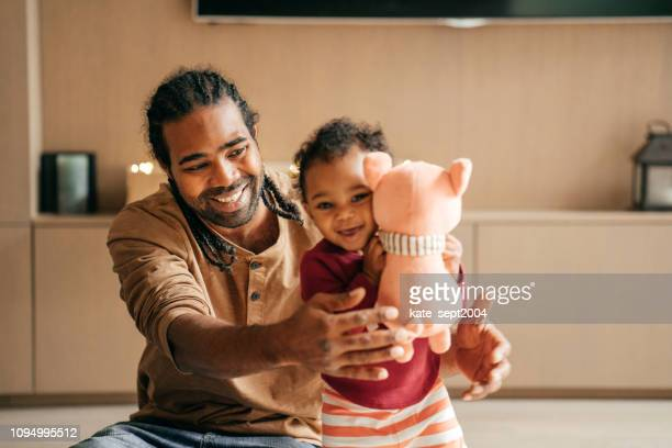 paternity leave and babysitting a baby girl - paternity leave stock pictures, royalty-free photos & images
