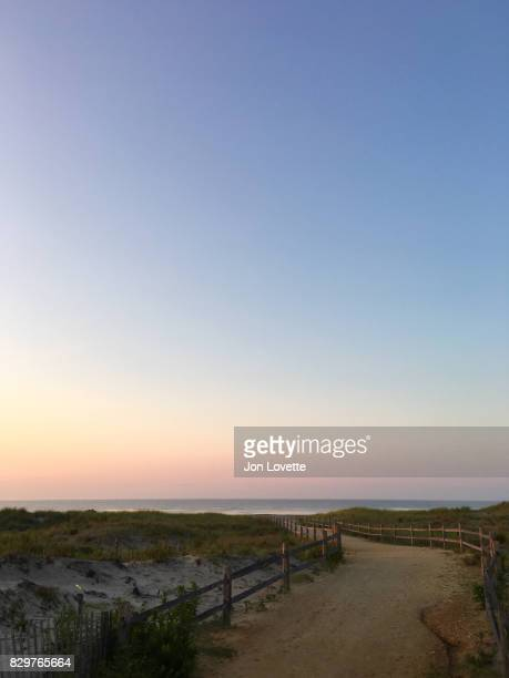 path and sunrise on the jersey shore - ocean city new jersey stock photos and pictures