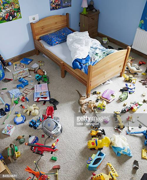 Path cleared through toys on floor of childs room