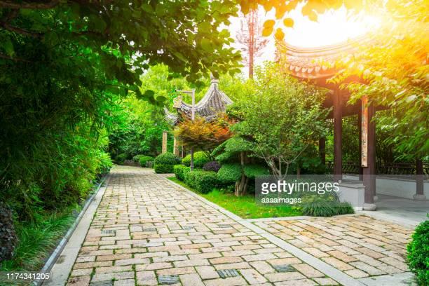 path in garden of suzhou - パビリオン ストックフォトと画像