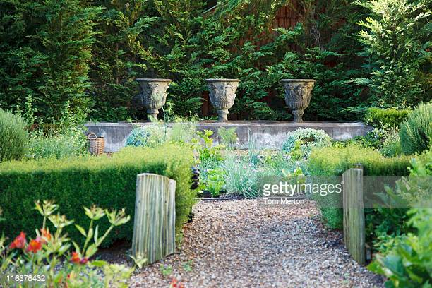 path in garden - decorative urn stock pictures, royalty-free photos & images
