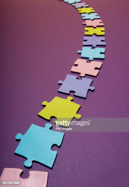 Path of multi colored puzzle pieces