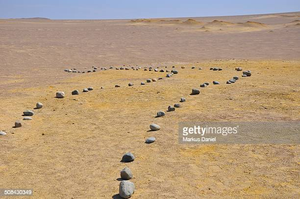 Path of pebbles in the desert of Paracas, Peru